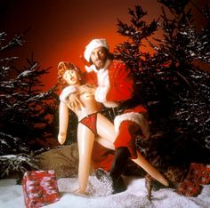 Ian Anderson of Jethro Tull dresses as Father Christmas and accessorizes with a blow-up doll in this portrait from 1980.