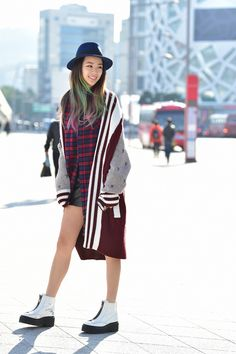 Street style: Irene Kim at Seoul Fashion Week Spring 2015 shot by Baek Seung Won. #streetstyle