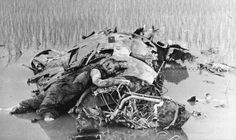 An American pilot lies dead on the wreckage of his plane in North Vietnam October 14th 1967 [1185 x 707]