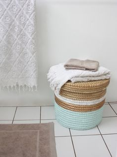 DIY Trend: Painted Baskets - The painted basket trend may not be brand new, but it seems to keep growing. It's easy, it looks good, and it's an inexpensive way to update your storage space, (especially if you've used the same baskets for years) Painted Baskets, Wicker Baskets, Bamboo Basket, Painted Wicker, Hand Painted, Diys, Paint Storage, Toy Storage, Storage Ideas