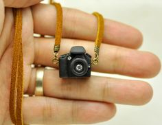 Canon Camera miniature necklace by JnPol on Etsy But I want it personalized w a photo of my kids and silver findings! Miniature Crafts, Miniature Dolls, Miniature Camera, Camera Necklace, Barbie House, Barbie Camper, Photography Accessories, Mini Things, Biscuit