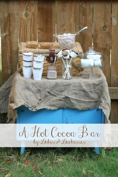 A Holiday Hot Cocoa Bar Cocoa mix in mason jar, marshmallows on stand, whipped cream with melted choc folded in, Marsh. on stick dipped in choc and rolled in heath, cups done the same....    Chocolate Dreams!!!  :)