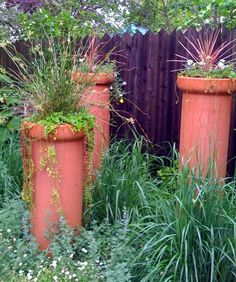 clay pipe planters, I've been trying to find some clay storm sewer piping or chimney flues that are so I can do something like this.  Anyone know where I can find any?
