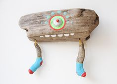 Yes, it's a monster made of driftwood. His name is Pablo. This pin is from EtsyGermany and it is so cute.... a perfect decoration for a kids bedroom