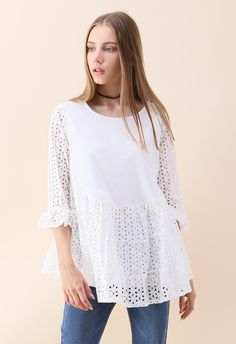"""We can't stop clutching our hearts over this """"Loveliness attack"""" embroidered dolly tunic top with a flared silhouette and ice white hue.    - Round neckline  - Floral embroidery with eyelet  - Ruffle hem  - Lined  - 100% Cotton  - Hand wash cold    Size(cm)Length Bust Shoulder Sleeves  S/M        70   102    37      42  Size(inch)Length Bust Shoulder Sleeves"""