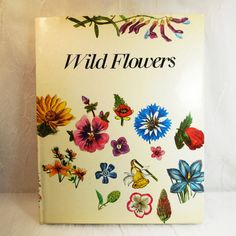 Wild Flowers  Matthias Hermann  First Edition 1973  by CraveCute Vintage book titled Wild Flowers. Text by Matthias Hermann and translated by Grace Jackman. Fantastic engravings by Redoute, Besler and several artists. Published in 1973 by Galahad Books NY, printed in West Germany.  This hardcover book includes gorgeous floral art prints of every imaginable species of wild flower that the author, botanist Matthias Hermann, could find. Mr Hermann includes the Latin as well as common name for…