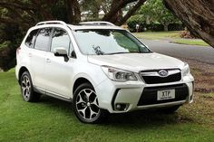 wish list!  :)   new Subaru Forester in Satin Pearl White or Silver to go with my little white house. Dream on...
