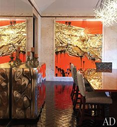 An Anselm Reyle mixed-media work in a Peter Marino designed home's dining room.