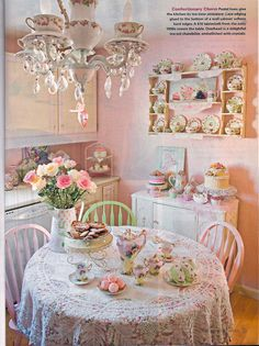 If you added a funky tablecloth instead of the lace and some pottery barn type dishes this would be adorbs in your kitchen! Look at the different color pastel chairs :-)