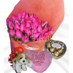 Send this 3 dozen cerise roses in a bouquet to your wife on Christmas Day with pink heart shaped pillow, stuff dog and ferrero rocher heart. Make your feelings known loud and clear with a fresh bouquet of exquisite pink roses, an unforgettable gift of sophisticated beauty. Online Flower Shop, Ferrero Rocher, First Anniversary, Perfect Match, Chocolates, Pink Roses, Heart Shapes, Bouquet, Bear