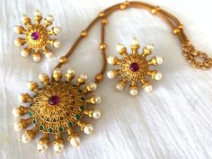 Jewelry OFF! Antique Matte Gold finished suryakanti pendant set with matching stud earrings / Indian wedding jewelry/ Temple jewelry/ Bridal jewelry Gold Mangalsutra Designs, Gold Earrings Designs, Gold Jewellery Design, Gold Pendent, Pendant Set, Pendant Jewelry, Indian Wedding Jewelry, Bridal Jewelry, Gold Jewelry Simple