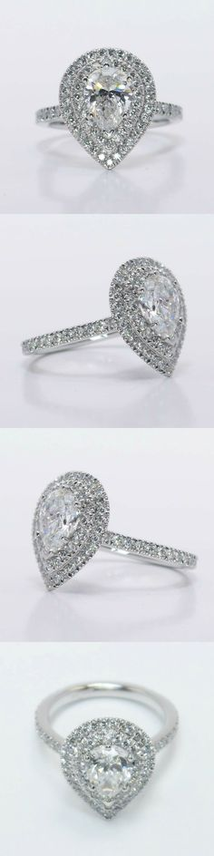 Custom Double Halo Diamond Engagement Ring! Pear 1.02 Ctw. Color: E Clarity: SI1 Polish: Very Good Diamond/Gem Cost: $3,833 Metal: Platinum Side Shape: Round Side Carat: 0.68 Side Color: F Side Clarity: VS2 Setting Cost: $2,995 https://www.brilliance.com/recently-purchased-rings/custom-double-halo-diamond-engagement-ring