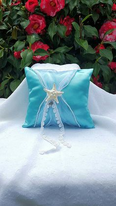 Check out this item in my Etsy shop https://www.etsy.com/listing/251415000/little-mermaid-ring-bearer-pillow-beach