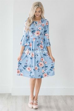 You can never have too many of our soft and comfy floral pocket dress! This beautiful sky blue dress features a soft peach floral print, has an elastic waist, cute bell sleeves, and adorable side seam pockets!