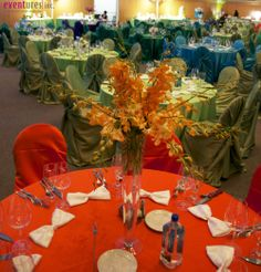 Orange table with matching flowers ~ #eventdecor #party #colorful #bowtie #napkin #eventuresinc