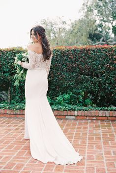 Off-the-shoulder lace wedding dress: http://www.stylemepretty.com/2017/01/23/from-high-school-sweethearts-to-happily-ever-after/ Photography: This Modern Romance - http://thismodernromance.com/