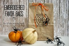 Brown paper packages tied up with ribbons and spiders.