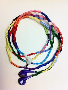 so cute! earbuds that look like friendship bracelets, wrapped with string! very cute!