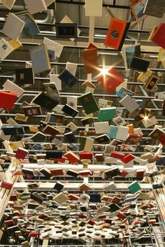 It's raining books. This is the ceiling of a booth made out of books by Jan Reymond for the Geneva Book Fair. Book Sculpture, Sculptures, Book Installation, Library Inspiration, Library Ideas, Library Displays, Book Displays, Library Design, Library Books
