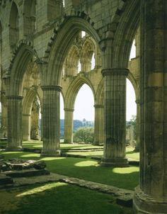 View of arches, Rievaulx Abbey, North Yorkshire, The abbey was one of the foremost Cistercian monasteries in medieval Britain. The arcades of the abbey church convey the glory and splendour that Rievaulx once possessed. (Photo by English Beautiful Architecture, Beautiful Buildings, Art And Architecture, Beautiful Places, Ancient Architecture, Slytherin Aesthetic, Kirchen, Historical Sites, Abandoned Places