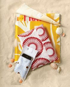 Beach Cover-ups for books, phones, ipods, etc made from those dollar store flannel backed tablecloths.  Easy Peasy!!