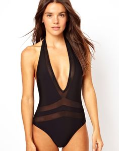 Black swimsuit with mesh cutouts, perfect summer swimwear trend.