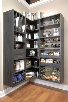 Install colored shelving. Another twist on color is to keep the walls white but use colored shelving. The gray shelving unit gives this pantry an entirely different aesthetic than that of a white-on-white pantry.