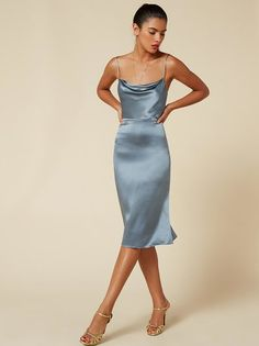 Slip into this. This is a tight fitting dress with a cowl neck and adjustable straps.