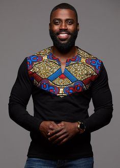 Our Lanre African print Men's long sleeve black shirt in our red blue tan applique is perfect for cooler weather! Shop our Men's African clothing and find your new favorite African print shirt. African Fashion Designers, African Print Fashion, Africa Fashion, African Print Shirt, African Clothing For Men, African Attire, African Wear, African Outfits, Chemise Fashion