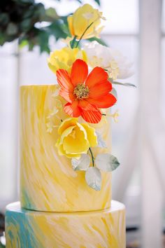 Van Gogh inspired yellow and blue hand painted wedding cake for a colorful Amsterdam wedding.  Click to see more images of this gorgeous spring wedding by destination wedding planner, Mango Muse Events!