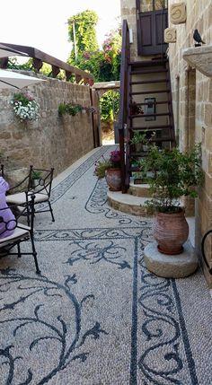 By Stelios Grecos http://www.anakatagallerycafe.com/grecos/index_uk.htm at Hotel Ellique, Rhodes Island, Greece.