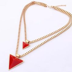 Geo pyramid necklace New in packaging. The colors are red and gold. Double layered box chain. Alloy metal. No trades. Jewelry Necklaces