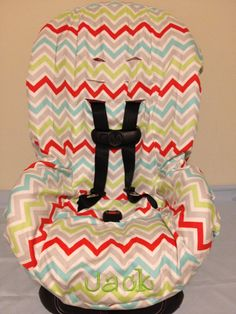 CHEVRON multi color or you CHOOSE FABRIC to design your toddler Car Seat Cover. $35.00, via Etsy.