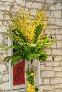 forsythia bells of ireland and palm arrangement with lemons and limes in the - Forsythia Arrangements