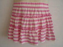 Set van 2 zomerse rokjes | kidsmetsmaak.nl  Set van 2 zomerse rokjes, waarvan 1 met gekleurde stippen en 1 met roze strepen. Elastische tailleband. 100% katoen Verkrijgbaar in de maten 80, 86 en 92