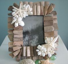 Seashell and driftwood frame. Doing this with our goodies from our next trip to Oregon!