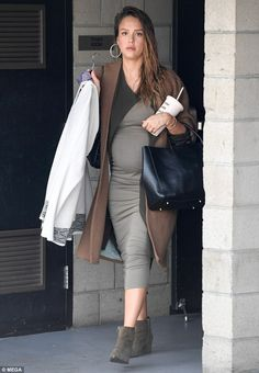 Looking sensational: Jessica Alba, 36, showed off her blossoming baby bump in a form-fitti...