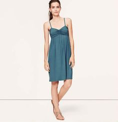 This would likely be too small in the bust for me, but love the color and empire waist. Ruched Cami Dress | Loft