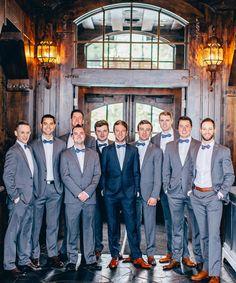 handsome grey tux groomsmen attire with blue bowties
