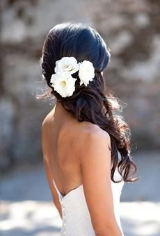 Curled, half-up wedding hair with white roses.........I like this one it's simple and this is a nice choice to do if we can't poof my hair right