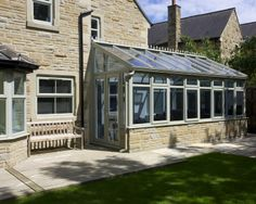 Nice colour against stone.... Coloured UPVC conservatory by Croft