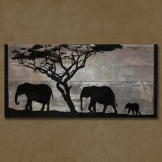 "Original Painting on Reclaimed BarnWood from South Dakota. This piece is 41"" long, 21"" tall & 1"" thick. The painting includes a scene straight from the African grasslands and features a family of elephants on the move. Each end is framed with 1"" angle iron. This piece comes with the hardware attached to the back and is ready to hang."