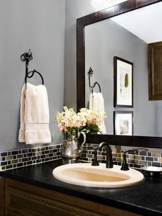 Just a small band of glass tile is a pretty AND cost-effective backsplash for a bathroom. Want to do in my master bath! New Selections: Minas Black soapstone, slate backsplash.