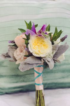 Garden rose, clematis, mint, herb and dusty miller bouquet -- photo by Amy Nicole Photography