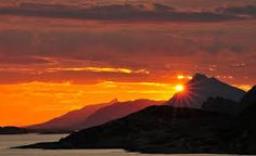 Image result for sunset over mountains and water