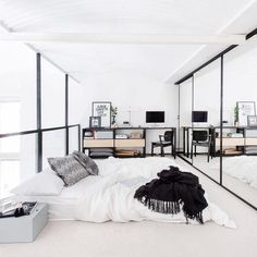 A lot of light and windows make for a more spacious looking bedroom layout.