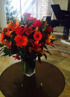 Formal ball ... Lobby lily centerpiece. Kenley Rose Events