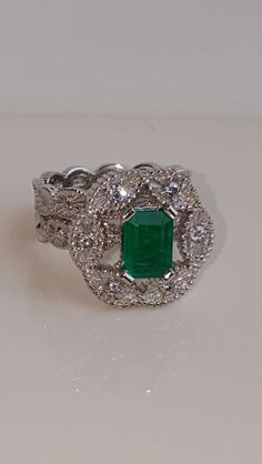 Platenium and emerald wedding ring and engagement ring