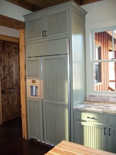 custom red oak refrigerator cabinet with side panels | kitchen