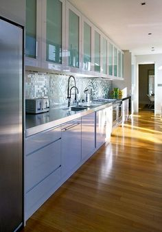 Backsplashes really complete a kitchen design! These sleek and innovative backspash designs by Alloy not only look sleek and sophisticated but they're also great for easy clean up!